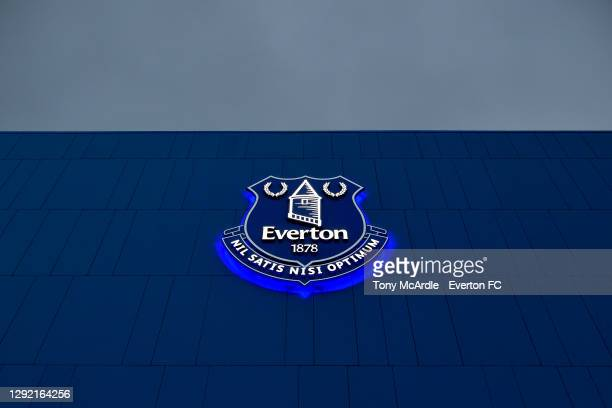 General view of an illuminated Everton crest on the Main Stand at Goodison Park before the Premier League match between Everton and Arsenal at...