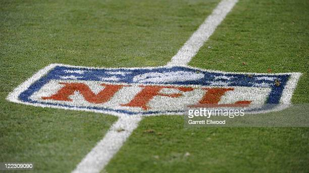 A general view of an NFL logo on the field prior to the preseason game between the Seattle Seahawks and the Denver Broncos at Sports Authority Field...