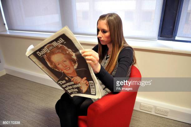 General view of an office worker reading The Daily Mail newspaper coverage from the reporting the news that the former British Prime Minister...