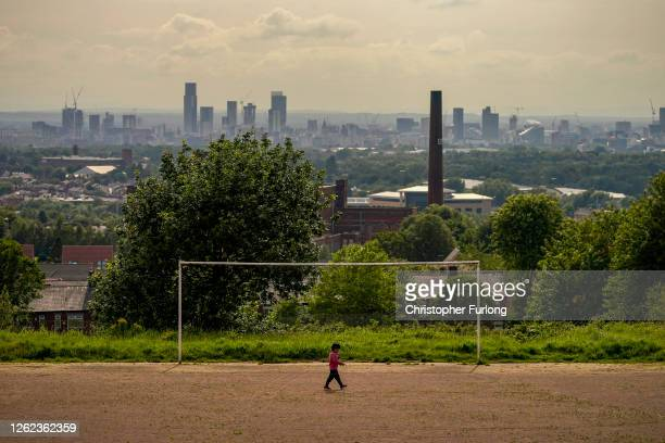 General view of an old cotton mill in Oldham with the city of Manchester on the horizon on July 29, 2020 in Oldham, England. Oldham Council is taking...
