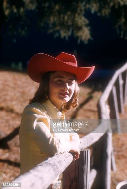 General view of an unidentified cowgirl of the west posing for a potrait circa September 1958 in Portland Oregon