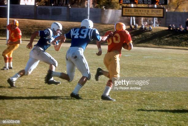 General view of an unidentified player from the Denver Pioneers getting horse tackled by the Air Force Falcons during an NCAA game on November 8,...