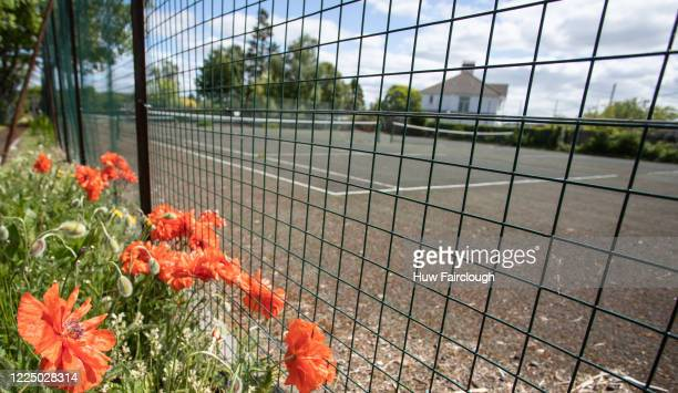 General view of an unused tennis court as restriction on tennis have been lifted in England but still remain in Wales on May 15, 2020 in Blackwood,...
