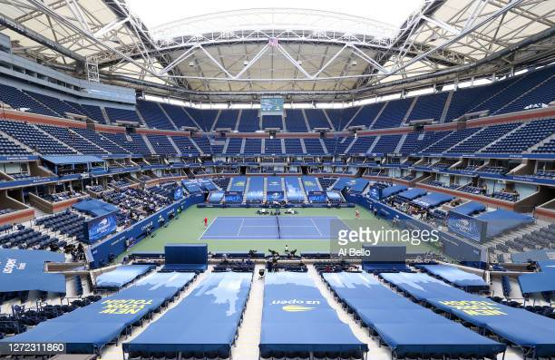 General view of Arthur Ashe Stadium is seen as Dominic Thiem of Austria serves the ball in the first set during his Men's Singles final match against...