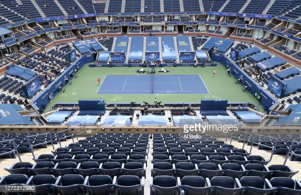A general view of Arthur Ashe Stadium is seen as Dominic Thiem of Austria serves the ball in the first set during his Men's Singles final match...