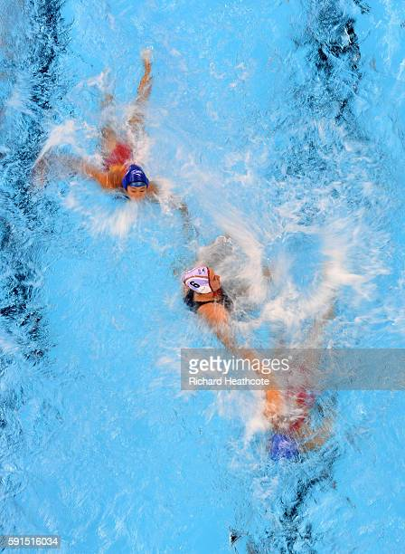 A general view of atheletes competing in the Women's Water Polo match between Spain and China at Olympic Aquatics Stadium on August 17 2016 in Rio de...