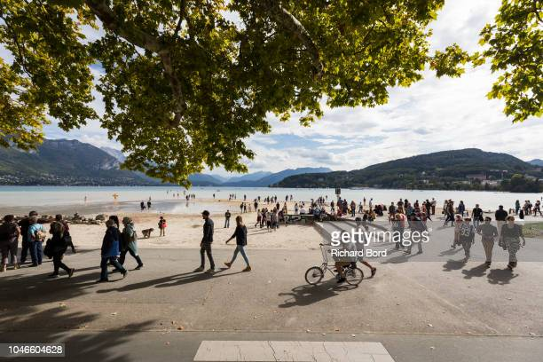 A general view of atmoshere on the Annecy Lake as people walk on the lake on October 6 2018 in Annecy France Lake Annecy has reached a low level due...