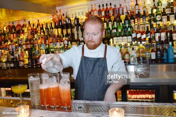 A general View of atmosphere a barman fixes Aperol Spritz cocktails during the 'Pizzeria Popolare 'Launch Party at Rue Reaumur in Paris on March 15...