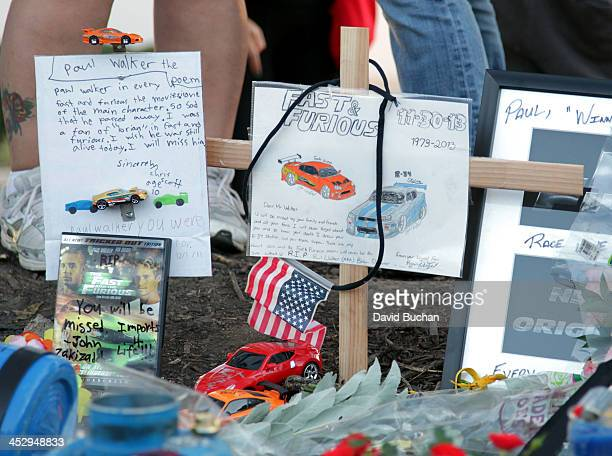 General view of atmosphere as fans pay tribute to actor Paul Walker at the site of his fatal car accident on December 1, 2013 in Valencia,...