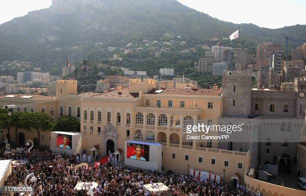 A general view of atmosphere as well wishers watch on the big screen the civil ceremony of the Royal Wedding of Prince Albert II of Monaco to...