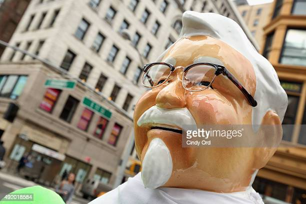 A general view of atmosphere at Colonel Sanders Statues Activation at New York Comic Con 2015 on October 9 2015 in Union Square New York United...