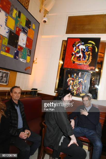 A general View of atmosphere with Marc Cerrone paintings during Marc Cerrone Exhibition Preview at Deux Magots a on March 12 2018 in Paris France
