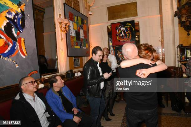 A general view of atmosphere with Marc Cerrone paintings exhibited during Marc Cerrone Exhibition Preview at Deux Magots on March 12 2018 in Paris...