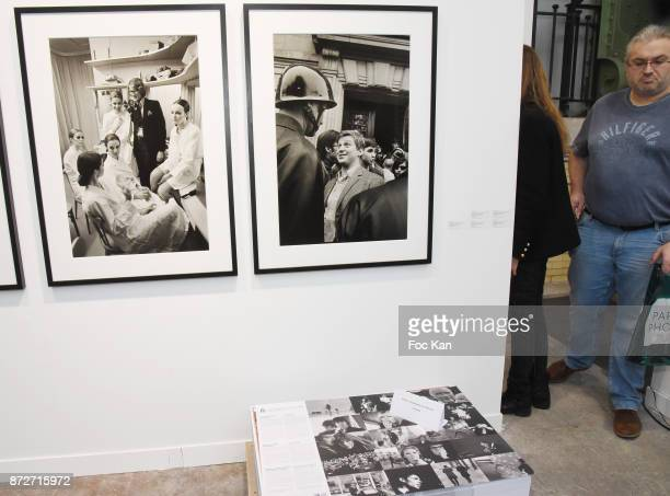 A general view of atmosphere with portraits of Yves Saint Laurent and Daniel Cohn Bendit by photo reporter Gilles Caron during Paris Photo 2017 Day...
