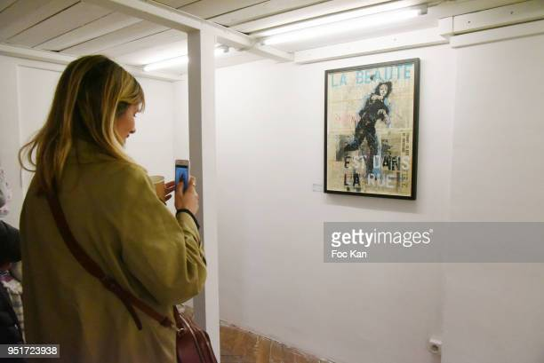 A general view of atmosphere with the work of Guy Denning during Mai 68 Collective Painting Exhibition at Brugier Rigail Galerie on April 26 2018 in...