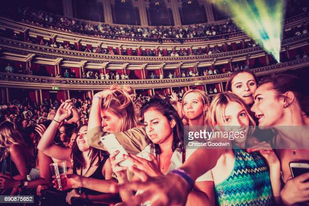 General view of audinece members in the front rows of the crowd as Sigma performs on stage at The Royal Albert Hall on May 27 2017 in London England