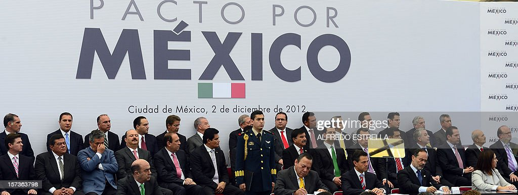 General view of authorities during the signing of the 'Pact for Mexico', on December 2, 2012 in Mexico City. Mexican President Enrique Pena Nieto and the main three polical parties of Mexico, signed Sunday an agreement to launch reforms to strengthen democracy, fight social inequality and promote economical growth. AFP PHOTO/Alfredo Estrella