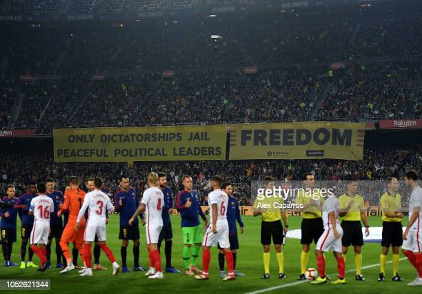 General view of Banners being held by fans as the players shake hands prior to kick off during the La Liga match between FC Barcelona and Sevilla FC...