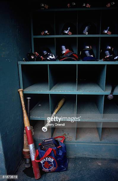 General view of baseball helmets and bats in a dugout equipment rack at Fenway Park as the Boston Red Sox host the New York Yankees on August 1 2003...