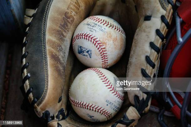 General view of baseballs resting in a catcher's glove is seen during a regular season game between the Louisville Bats and the Toledo Mud Hens on...