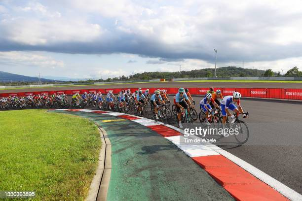 General view of Benoit Cosnefroy of Team France and the peloton passing through Fuji International Speedway circuit during the Men's road race on day...