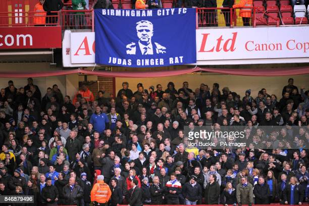 """General view of Birmingham City fans in the stands with a banner depicting former manager Alex McLeish that reads """"Judas Ginger Rat"""""""