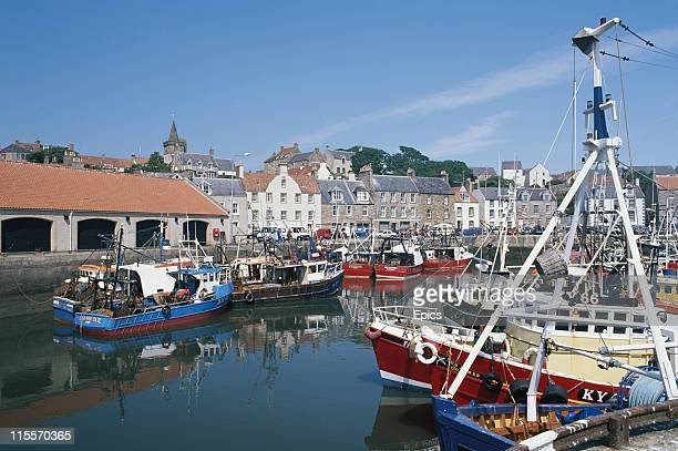 A general view of boats moored at Pittenweem fishing harbour Fife Scotland June 1997