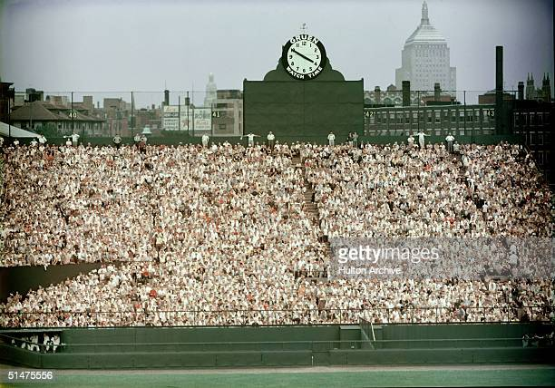 General view of Boston's Fenway Park, home of the American League baseball team the Boston Red Sox shows the fans packed in the bleachers in the...