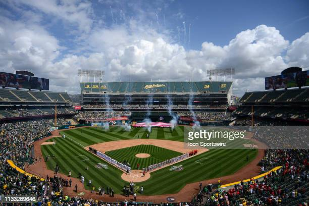 A general view of both teams on Rickey Henderson Field during the national anthem prior to the Major League Baseball game between the Los Angeles...