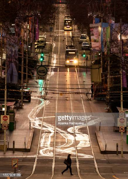 A general view of Bourke Street as a lone Pedestrian crosses the road on August 06 2020 in Melbourne Australia Retail stores across Melbourne are...