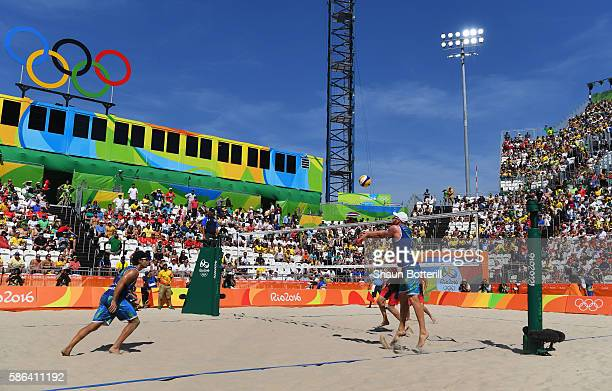 General view of Bruno Oscar Schmidt and Alison Cerutti of Brazil and Josh Binstock and Samuel Schachter of Canada in action during the Men's Beach...