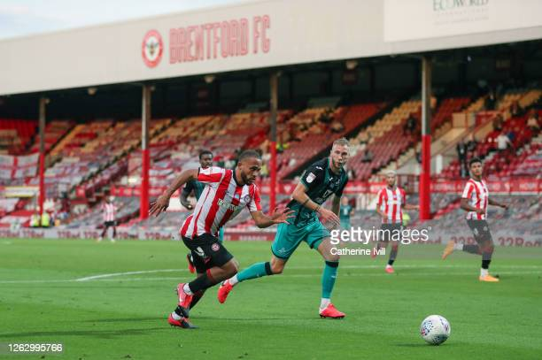 General view of Bryan Mbeumo of Brentford and Mike van der Hoorn of Swansea during the Sky Bet Championship Play Off Semifinal 2nd Leg match between...