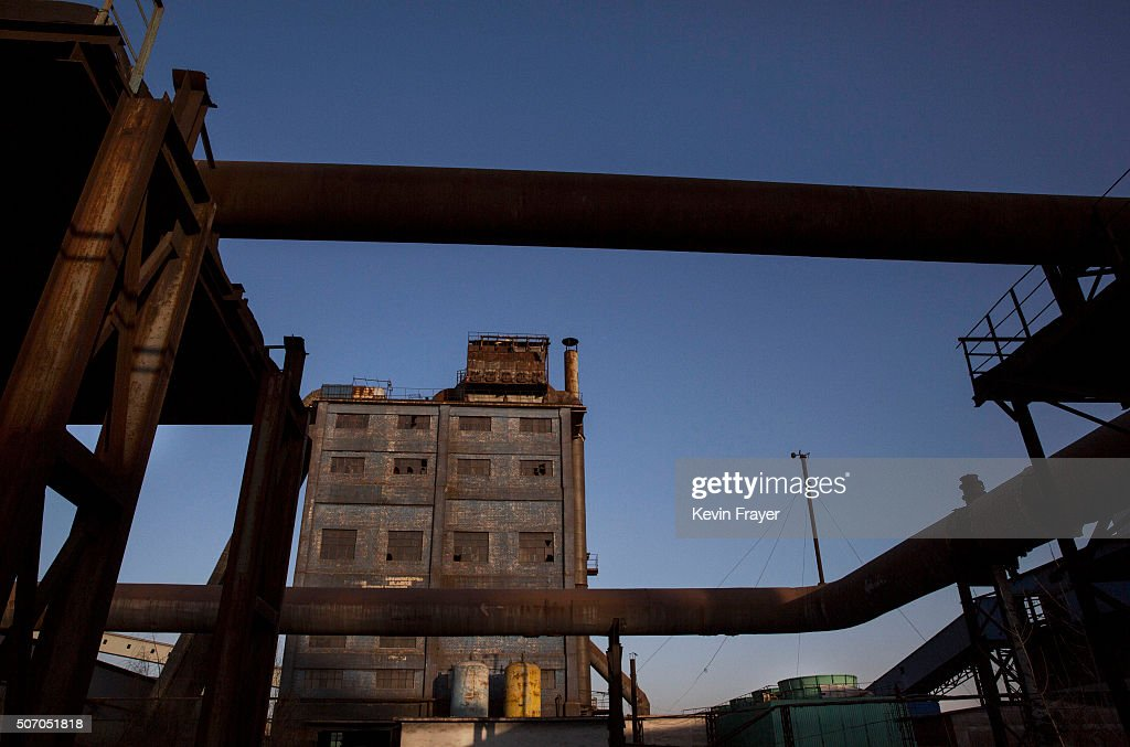 A general view of buildings in the abandoned Qingquan Steel plant which closed in 2014 and became one of several so-called 'zombie factories', on January 26, 2016 in Tangshan, China. China's government plans to slash steel production by up to 150 million tons, which could see the loss of as many as 400,000 jobs according to state estimates. Officials point to excessive industrial capacity, a slump in demand and plunging prices as they attempt to restructure China's slowing economy. Hebei province, long regarded as China's steel belt, once accounted for nearly a quarter of the country's steel output. In recent years, state-owned steel mills have been shut down and dozens of small privately-owned plants in the area have gone bankrupt.