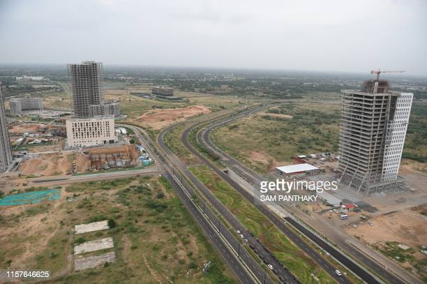 General view of buildings under construction is pictured at Gujarat International Finance Tec-city in Gandhinagar, some 30 km from Ahmedabad on July...