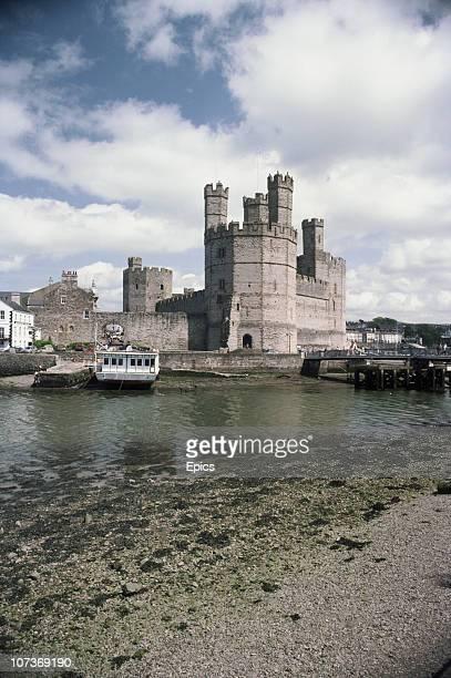 A general view of Caernarfon Castle Gwynedd Wales June 1983 Caernarfon castle is located at the southern end of the Menai straight