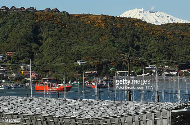 General view of Caleta Anahuac is seen from Estadio Chinquihue with Calbuco Volcano in the background on October 17, 2015 in Puerto Montt, Chile.