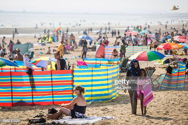 A general view of Camber Sands on August 25 2016 in Rye England Five men were found dead after being pulled from the sea on the hottest day of the...