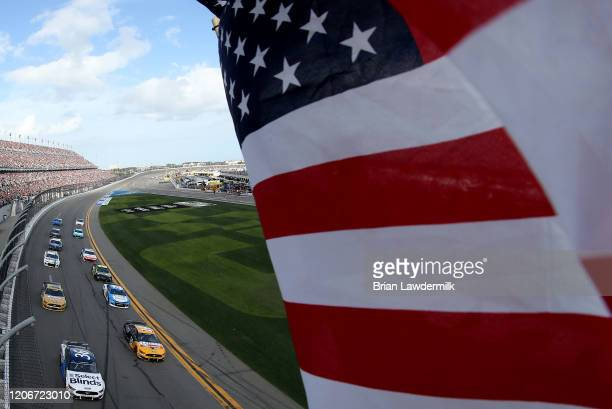 General view of cars during a parade lap before the start of the NASCAR Cup Series 62nd Annual Daytona 500 at Daytona International Speedway on...