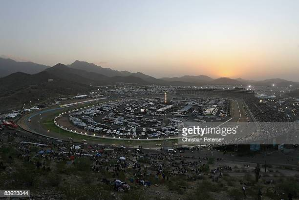 General view of cars racing as the sun sets at the NASCAR Sprint Cup Series Checker O'Reilly Auto Parts 500 at Phoenix International Raceway on...