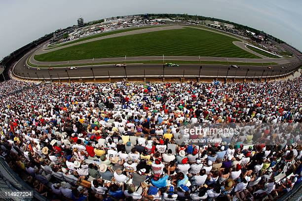 A general view of cars racing during the IZOD IndyCar Series Indianapolis 500 Mile Race at Indianapolis Motor Speedway on May 29 2011 in Indianapolis...