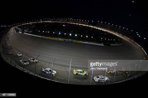 A general view of cars racing during the NASCAR Sprint Cup Series Bojangles' Southern 500 at Darlington Raceway on September 6 2015 in Darlington...
