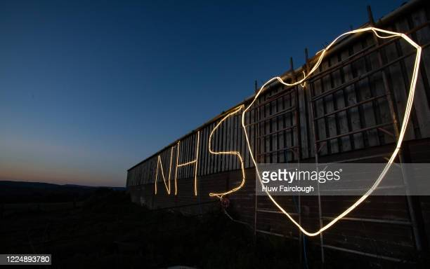A general view of Cefn Caerllwyn Farm where the owners have illuminated the side of a barn in support of the NHS on May 14 2020 in Blackwood Wales...