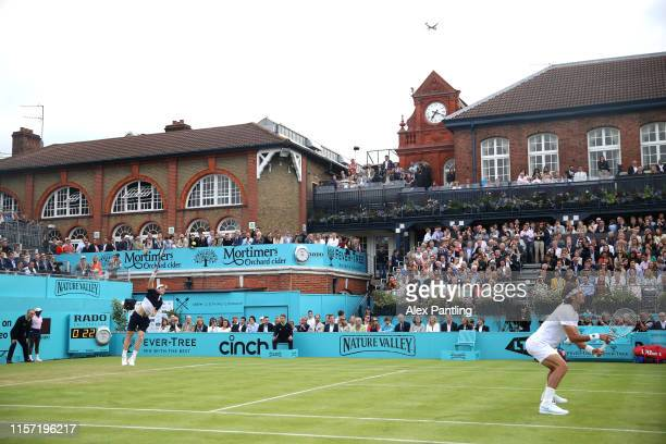 General view of centre court as Andy Murray of Great Britain, partner of Feliciano Lopez of Spain serves during his First Round Doubles match against...