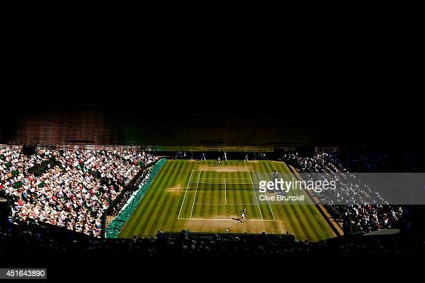 General view of centre court as Eugenie Bouchard of Canada returns during her Ladies' Singles semifinal match against Simona Halep of Romania on day...