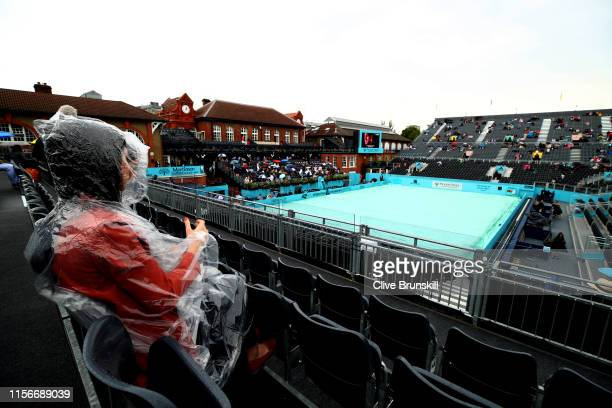 General view of Centre Court as fans shelter due to a rain delay during day Two of the FeverTree Championships at Queens Club on June 18 2019 in...