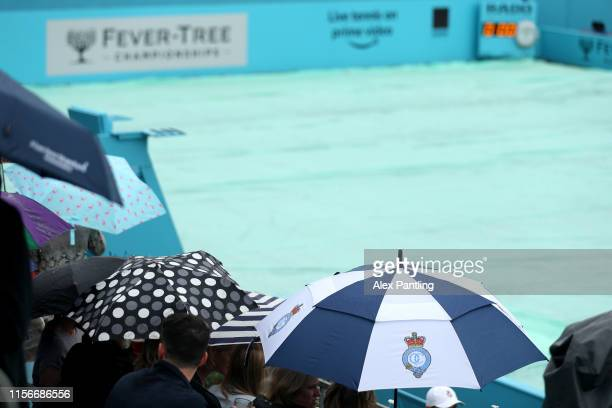 General view of Centre Court as fans shelter under umbrellas due to a rain delay during day Two of the FeverTree Championships at Queens Club on June...
