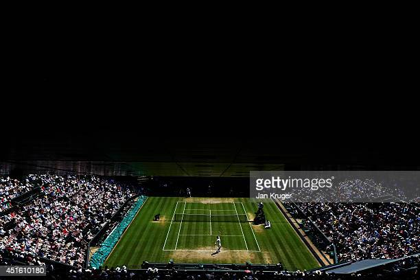 A general view of centre court as Grigor Dimitrov of Bulgaria serves during his Gentlemen's Singles quarterfinal match against Andy Murray of Great...