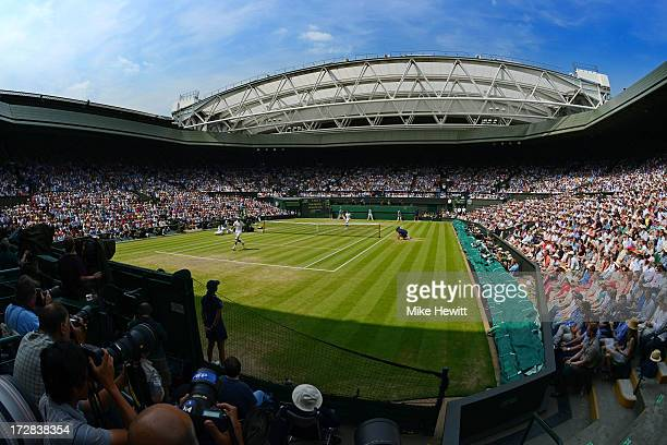 A general view of Centre Court as Juan Martin Del Potro of Argentina plays a shot through his legs during the Gentlemen's Singles semifinal match...