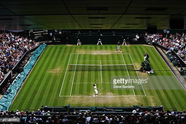 A general view of Centre court as Mikhail Kukushkin of Kazakhstan serves to Rafael Nadal of Spain during their Gentlemen's Singles third round match...