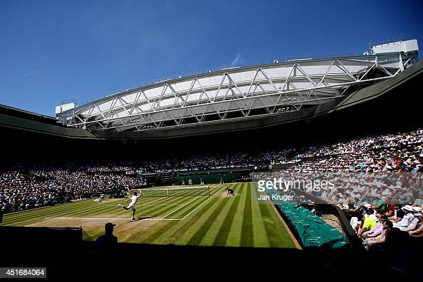 A general view of centre court as Novak Djokovic of Serbia returns during his Gentlemen's Singles semifinal match against Grigor Dimitrov of Bulgaria...